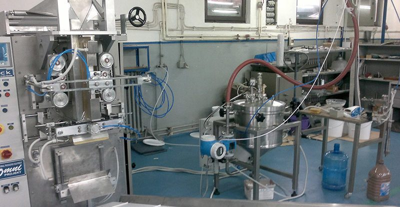 Vertical form fill and seal machine for liquid product