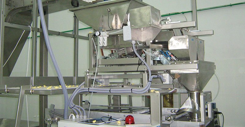 Vertical form fill and seal machine for packaging seed products
